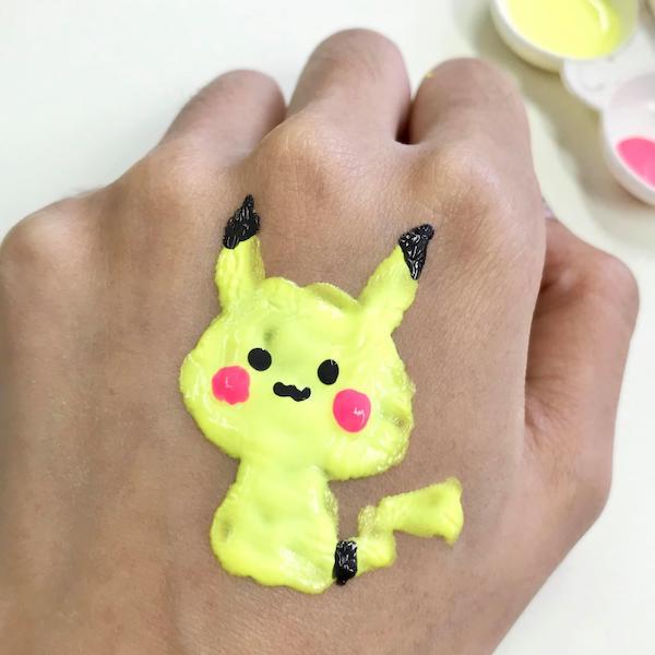 She writes Pikachu on her palm.